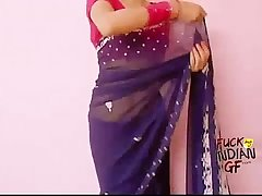Young indian wife teaching how to wear saree